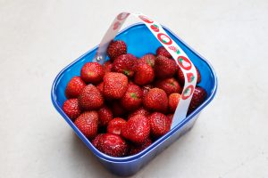 A punnet of freshly picked strawberries