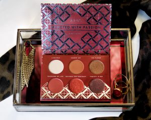 Zoeva Spice Of Life Palette Perfect for Winter Makeup Looks - Image of the eyeshadow palette sat in a glass jewellery box with gold jewellery surrounding it.