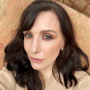 Brown purple smokey eye makeup on a brunette fair skinned blue eye woman