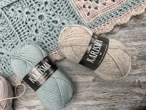 Choosing yarn for crochet blanket. Wool perfect for any home design in beige, light green and mink