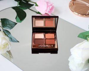 Desert Haze Eyeshadow palette sits open to show the warm brown tones.