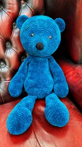 Crochet teddy bear in blue