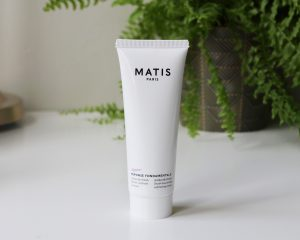 Matis Paris Parisian Escapes Harvest In Montmarte skincare gift set - the scrub stands on a table in front of a fern