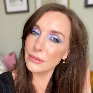 Amy wears an eye shadow look using blues and purples